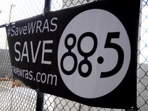 #SaveWRAS poster at university graduation ceremony