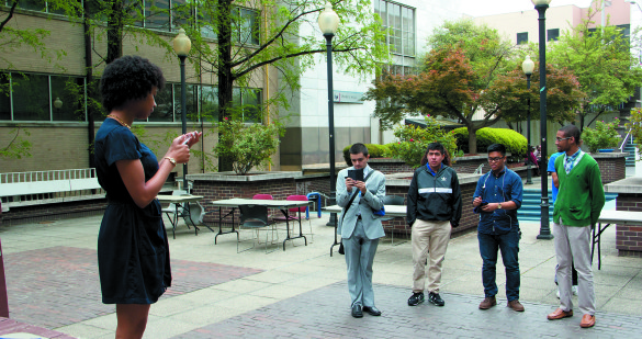 Nyomi Haynes announces the winning candidates for the 2015-2016 elections in Library Plaza Monday, April 13th.   Nadia Deljou | The Signal