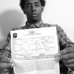 Georgia State student, Justin Avery, holds in his hand the police report that details the events of his arrest.